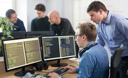 software-developer-working-on-desktop-co