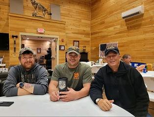 men and the lodge bear hunting.jpg