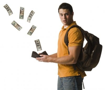 Kid with money flying away from his hands