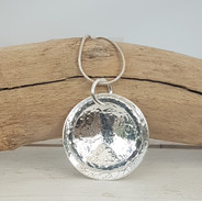 Sterling silver disc pendant, made by Michelle