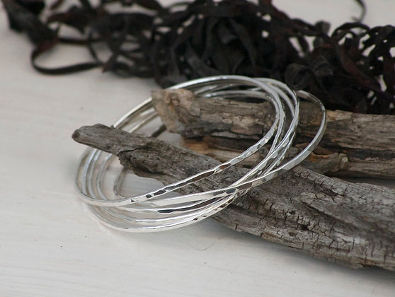 Five Sterling Silver Entwined Bangles