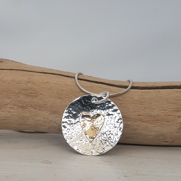 Sterling silver and rose gold heart pendant, made by Sara