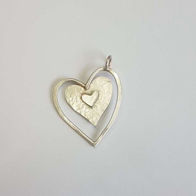 Sterling silver heart pendant, made by Maria