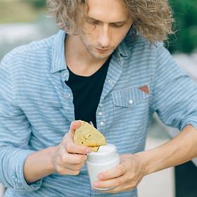Guy Eating Roti.png
