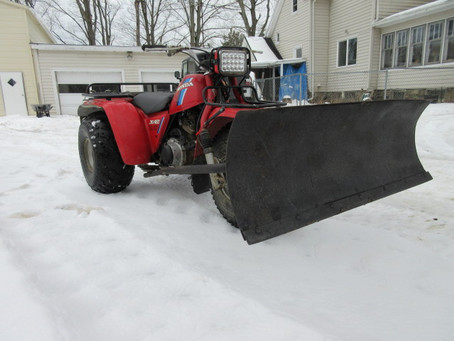 Plowing Snow with a BIG RED Three Wheeler