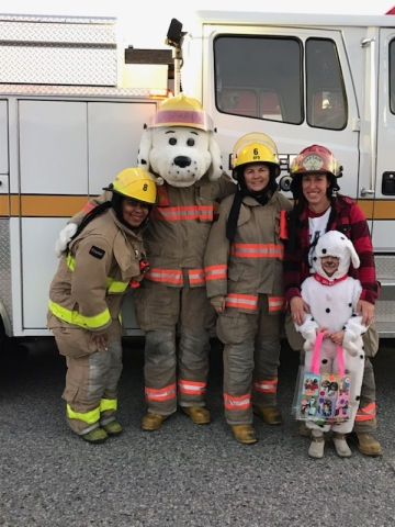 Firefighters handing out Halloween treats