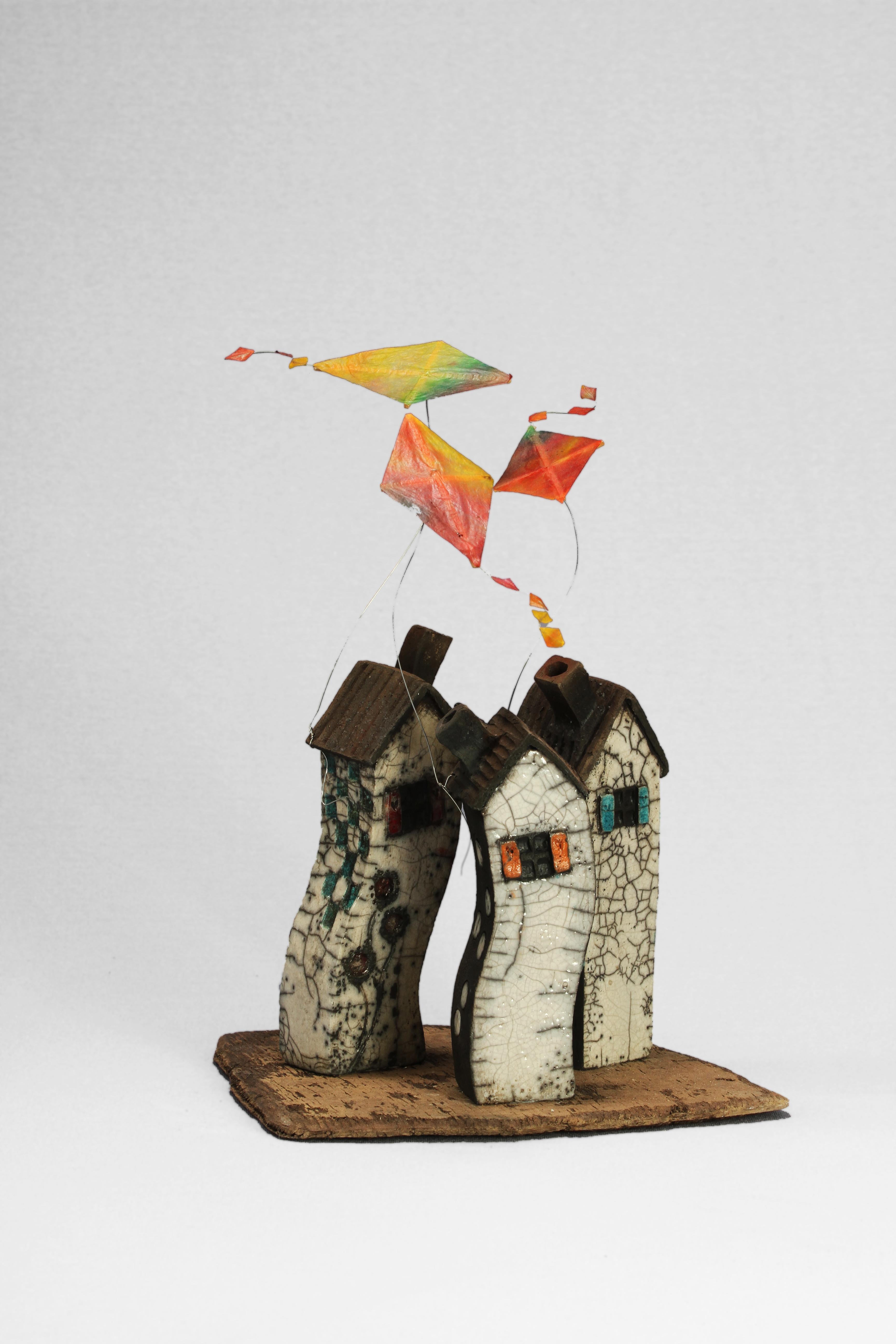 Trois maison dans le vent