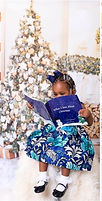 """Children with their copies of """"What I Love About Christmas"""" book."""