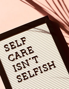 Canva - Self Care Isn't Selfish Signage.