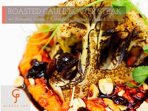 Roasted Cauliflower Steak w/ Romesco Sauce, PX Steeped Sultanas & Flaked Almonds