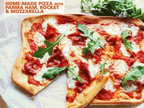 Pizza with mozzarella, parma ham and rocket