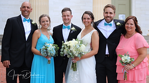Bride and groom with bride's family.