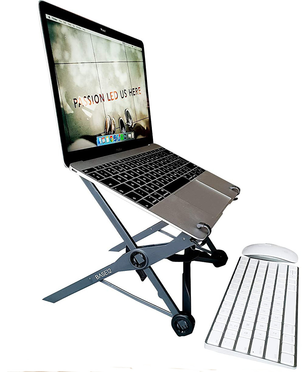 Portable, foldable laptop stand carrying a laptop with bluetooth keyboard and mouse
