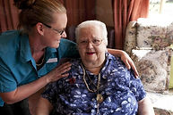 portrait-of-elderly-lady-with-carer-at-a