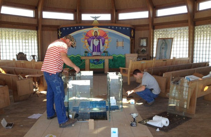 Theut Glass of Columbus, TX, working on the enclosure for the Pool of Mercy … March 4, 2016