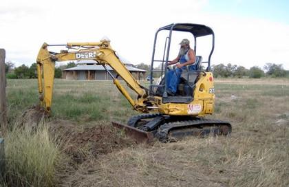Dennis Kallus Trenching for Upcoming Road Work … November 24, 2010