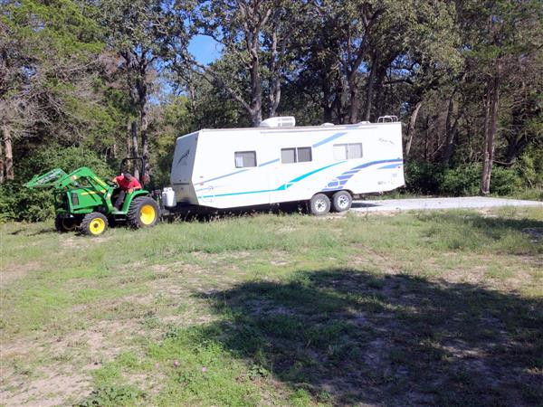 Volunteer Danny Vyvjala moving RV to its new concrete pad … October 7, 2014