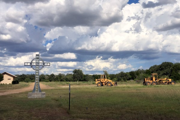 Kiner Trucking working on the parking area near the chapel … July 26, 2017