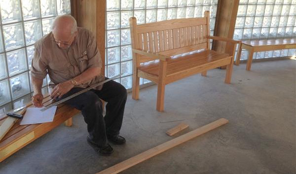 The first of 20 pews to be built by Ken Andrews … July 13, 2015