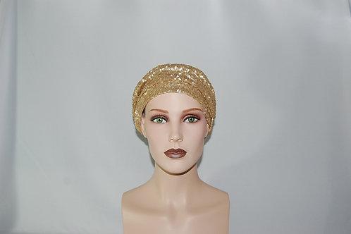 Turbante de lentejuelas doradas  con forro de tela de algodón