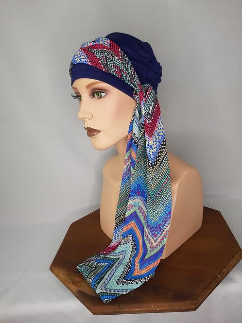 turbante en base de tela de bambú , color azul marino con pañuelo estampado en colores de moda