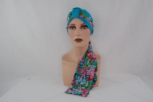 turbante de color turquesa con pañuelo estamapado de flores  ,  para personas con problemas de alopecia o calvicie