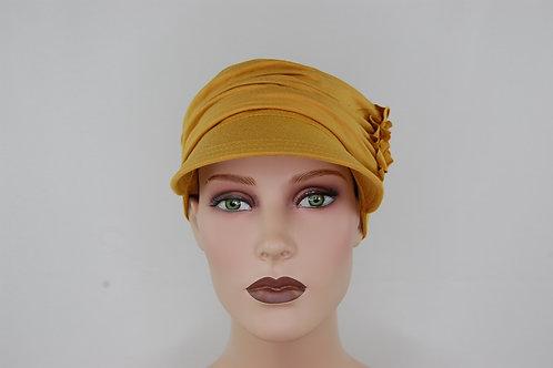turbante visera con vincha en tela de bambú  color  mostaza , muy suaves especiales para pieles sensibles