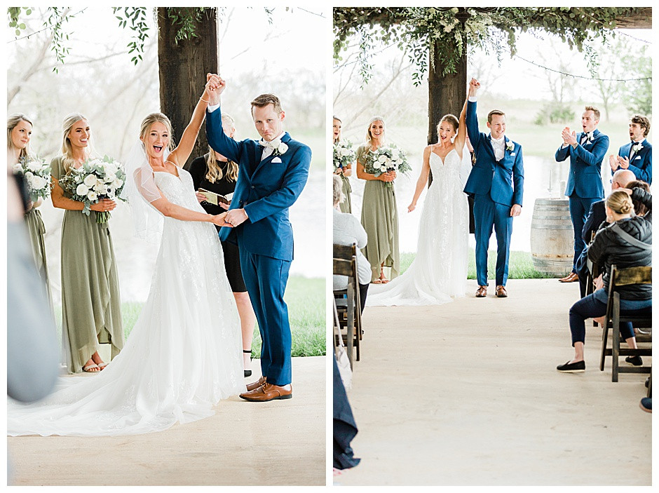 Bride and groom cheering after being announced husband and wife.