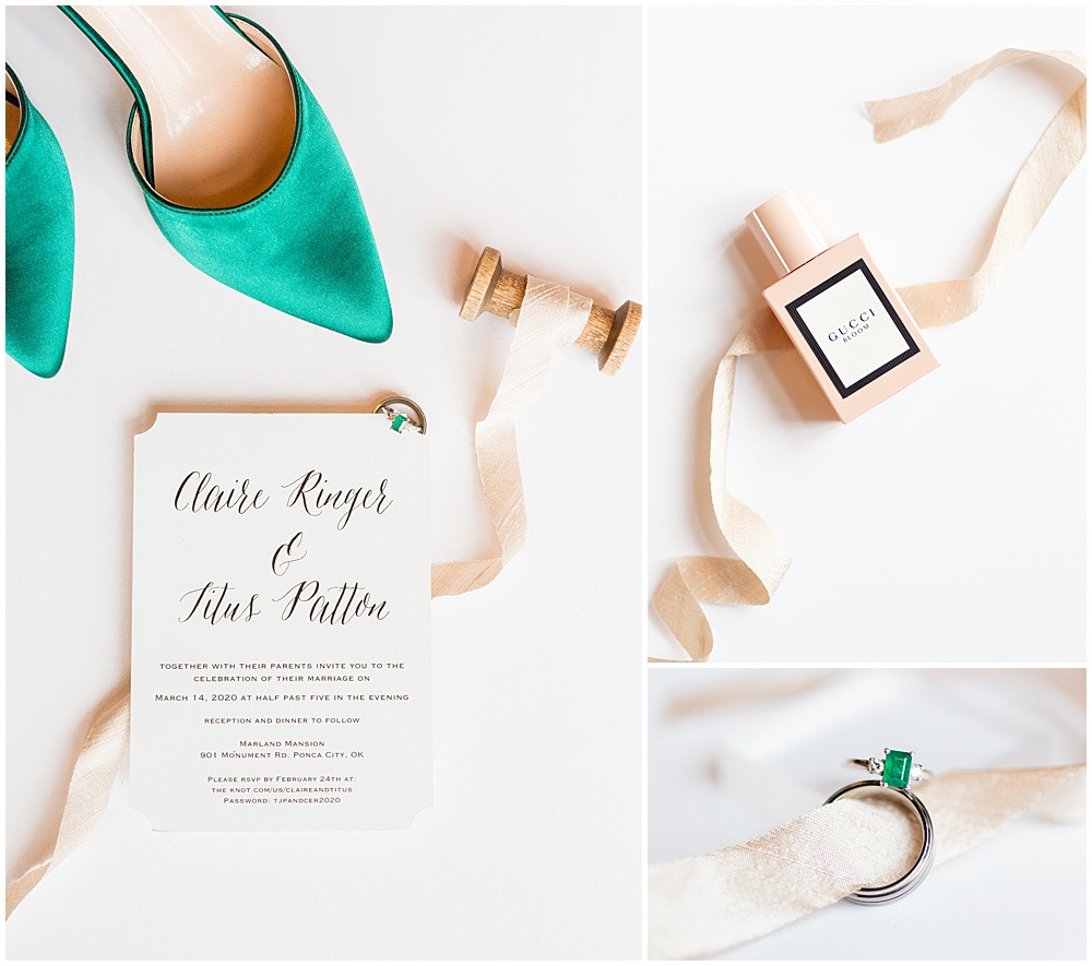 Wedding flat lay with emerald green shoes, an emerald ring, pink ribbon on a spool, a wedding invitation, and Gucci Bloom perfume.