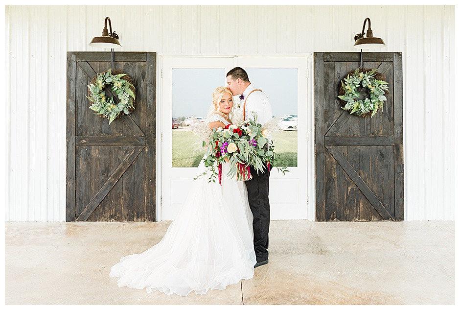 Bride and Groom in front of Southern Cedars Wedding venue entrance