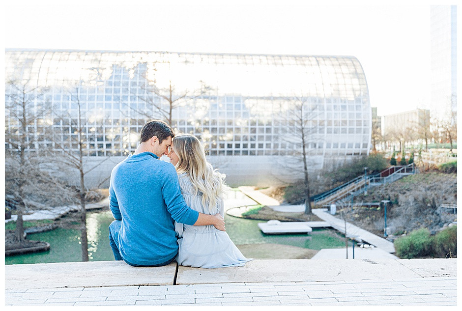 Couple sitting in front of Myriad Garden's Greenhouse.