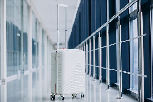 white-travel-bag-isolated-alone-by-gates