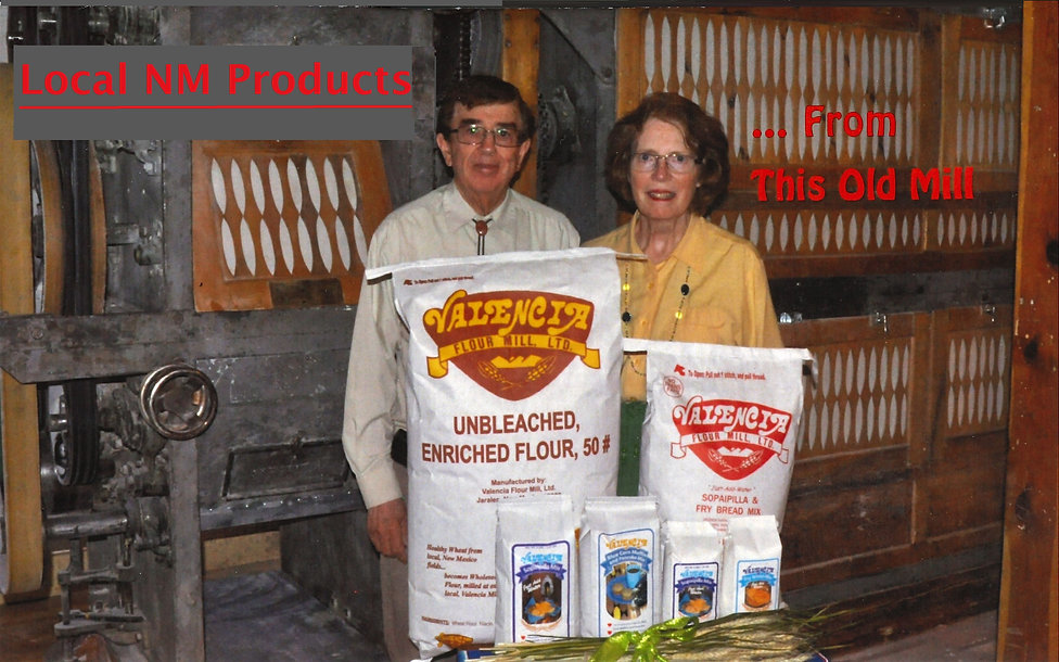 Jose & Kathy, Owners posing with 20th Centry Mill Machin & all Valencia Products