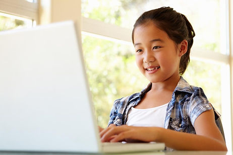 Girl taking Scratch and Python Coding Class