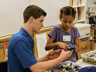 TechKnowHow Teacher Helping Student with LEGO Build