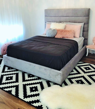 cute but chic little girls bedroom with pink pillows