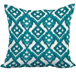 teal and white throw pillow with pattern