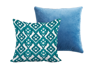 blue throw pillow paired with teal