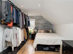 Open concept walk-in closet with wall hung rails