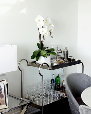 chic styled bar cart with orchid