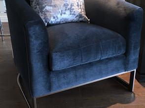 blue velvet chair with toss pillow