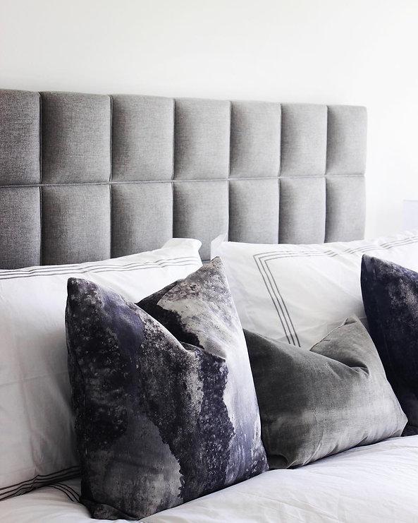 Modern headboard and throw pillows in Toronto Condo