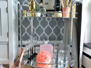 pink and gold accents on a chrome bar cart