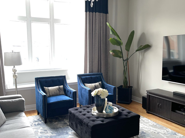 Blue chairs in a glam family room in vaughan