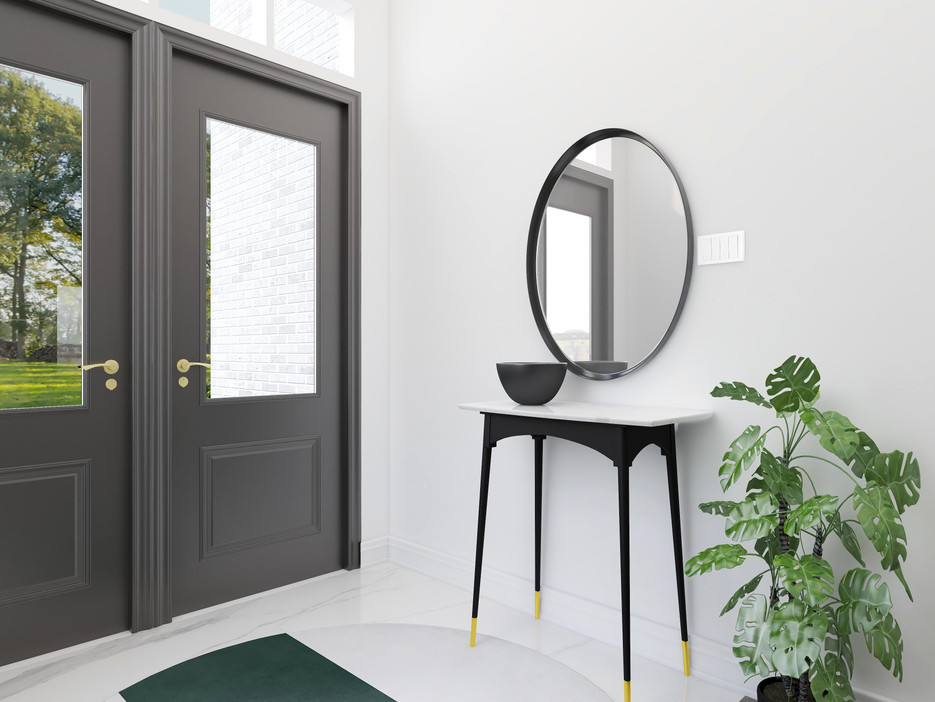 Modern Entry with green rug and round mirror