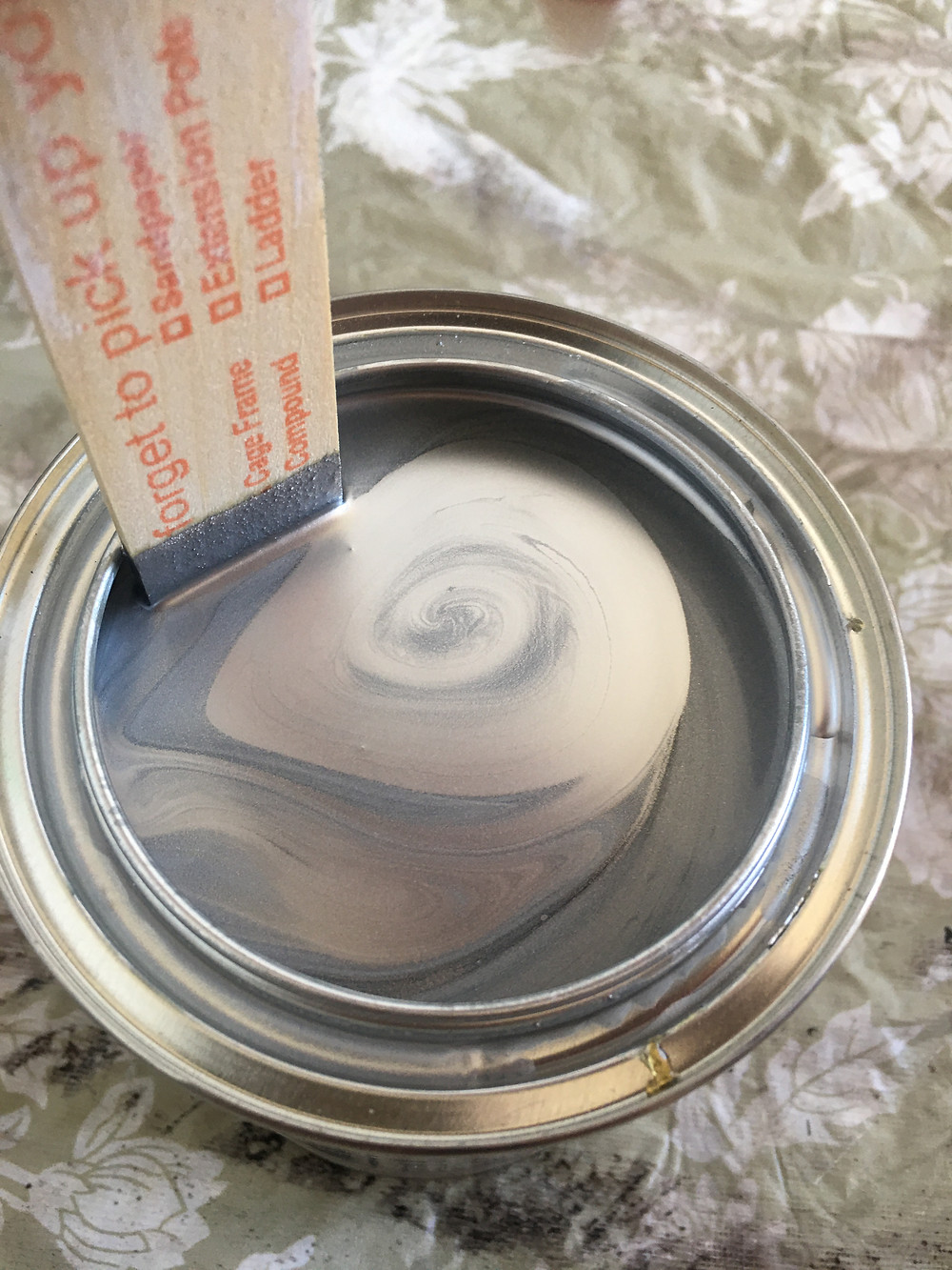 Silver metallic paint used to stencil a wall