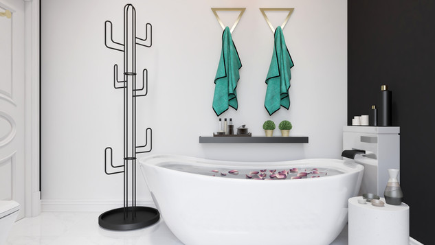 Cactus shaped coat rack beside a freestanding bathtub