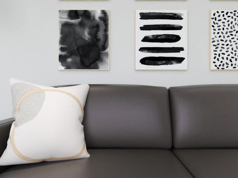 Structube throw pillow on a brown leather sofa