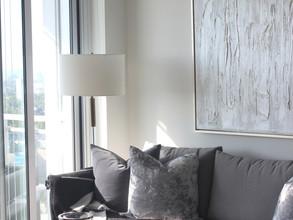 white textured artwork above sofa