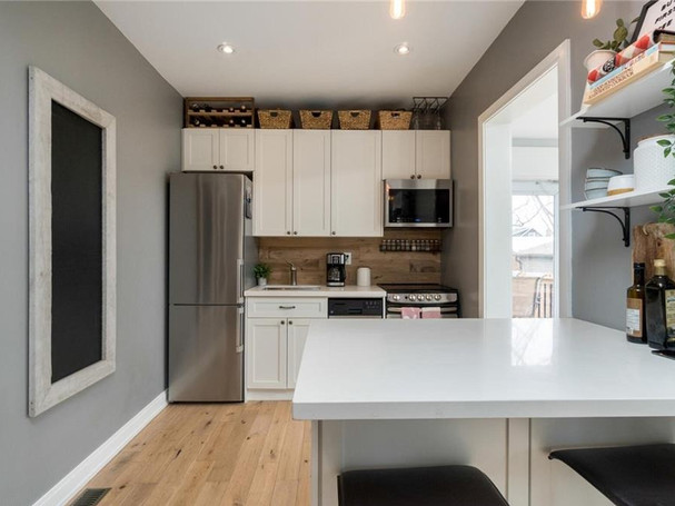 Farmhouse style kitchen in starter home for young couple
